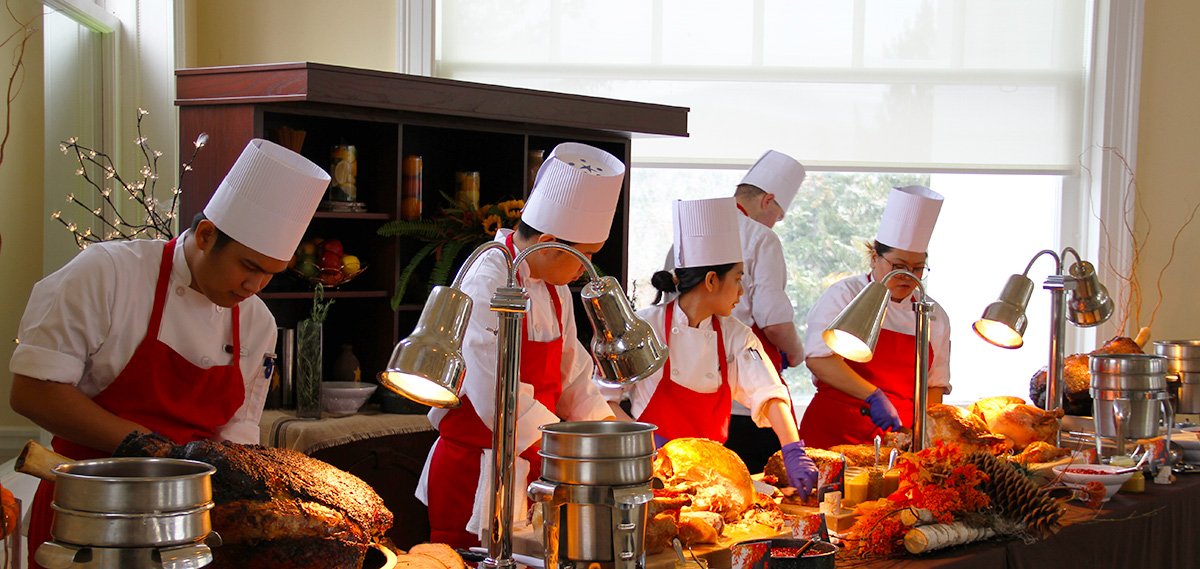 Chefs carving turkeys for Thanksgiving buffet in the Sun Dining Room