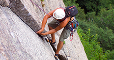 Man rock climbing using crack climbing techniques. Cathedral Ledge, NH