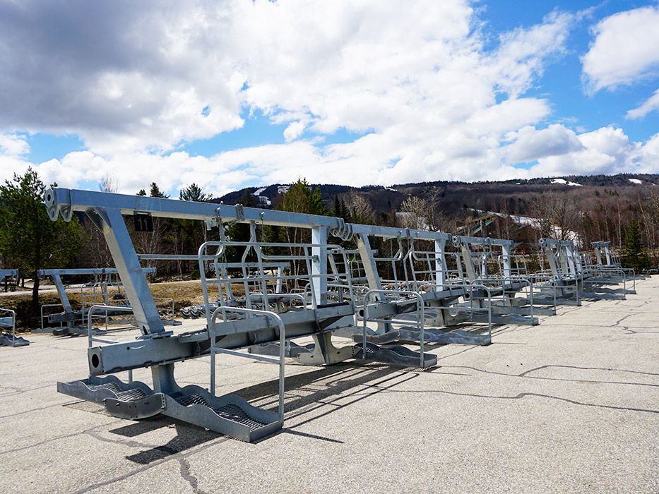 Gondola parts return from winter storage as construction resumes.