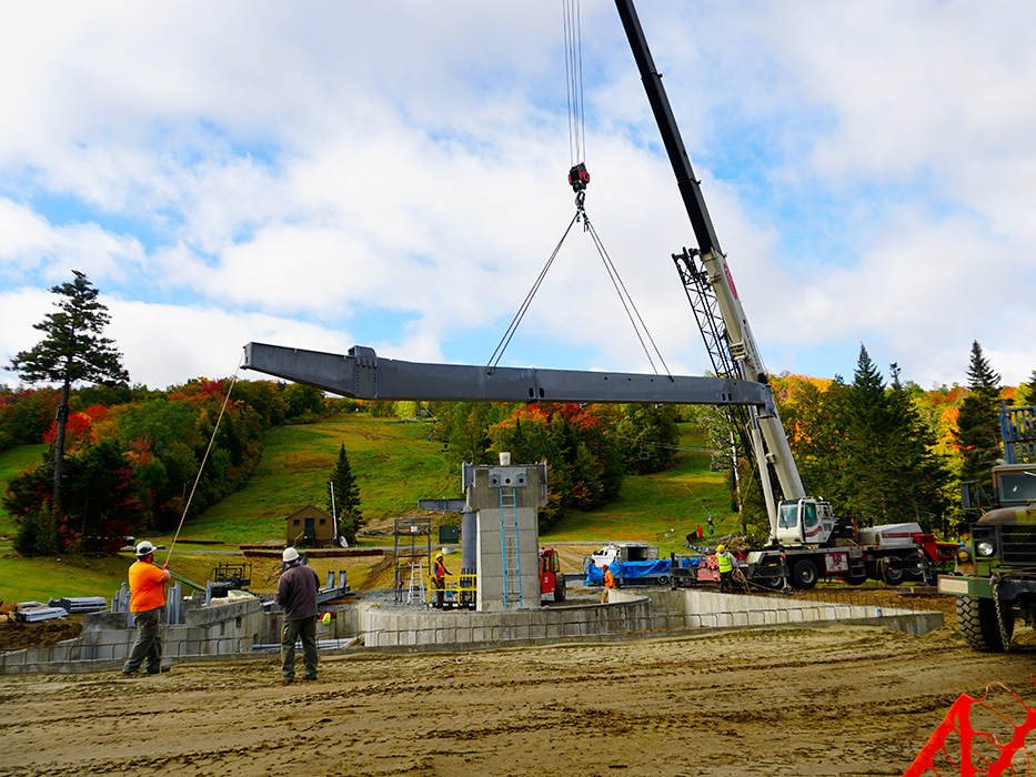Lowering the first piece of steel into place.