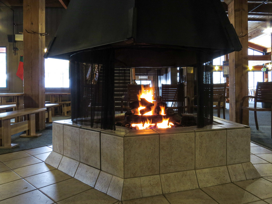Come up to the third floor to enjoy the Slopeside Pub and warm up by the fire!
